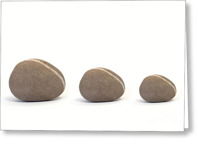 Three Pebbles Against White Background Greeting Card by Natalie Kinnear