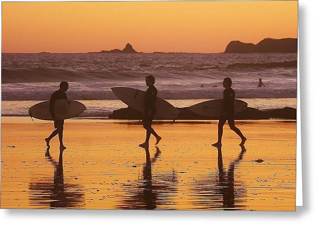 Three Surfers At Sunset Greeting Card