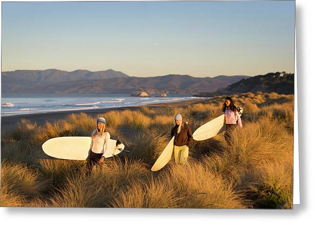 Three Women With Surfboards Walk Greeting Card