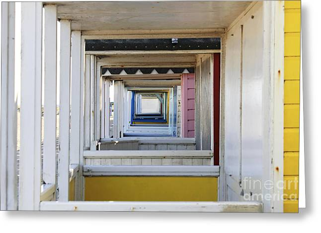 Through The Beach Huts Greeting Card
