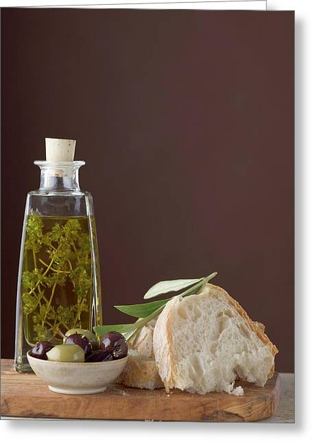 Thyme Oil In Bottle, Olives And White Bread On Chopping Board Greeting Card