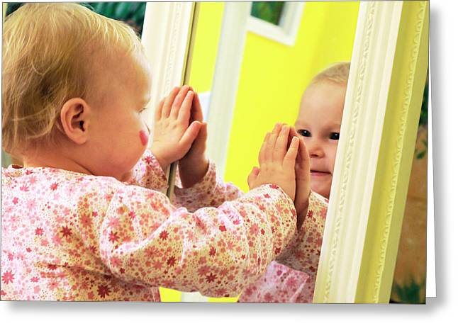Toddler Interacting With A Mirror Greeting Card by Thierry Berrod, Mona Lisa Production