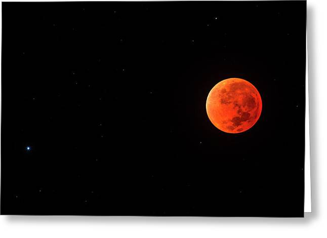 Total Lunar Eclipse And Spica Greeting Card by Babak Tafreshi