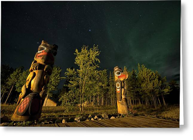 Totem Poles At Night. Tlingit Culture Greeting Card by Peter Mather