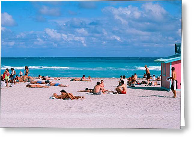Tourist On The Beach, Miami, Florida Greeting Card by Panoramic Images
