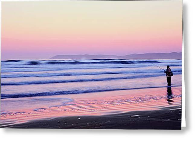 Tourists Fly-fishing On Beach Greeting Card by Panoramic Images