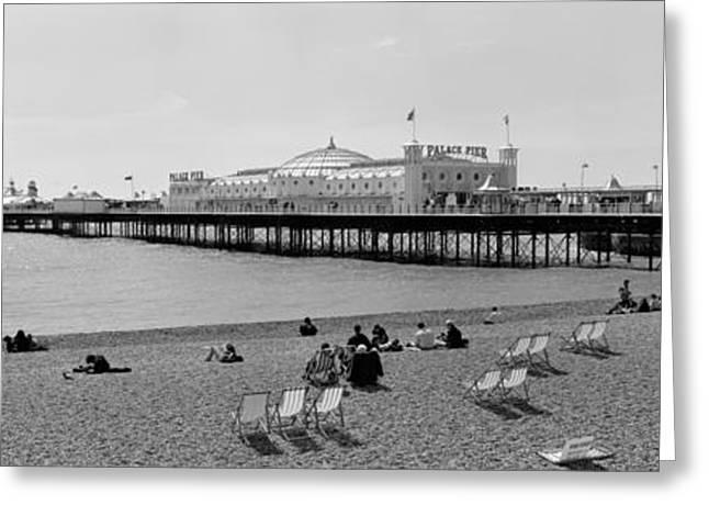 Tourists On The Beach, Brighton, England Greeting Card