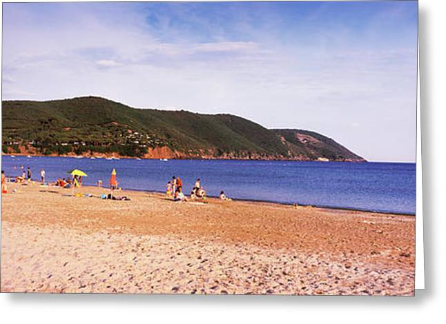 Tourists On The Beach, Island Of Elba Greeting Card by Panoramic Images