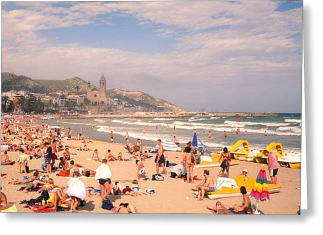 Tourists On The Beach, Sitges, Spain Greeting Card by Panoramic Images