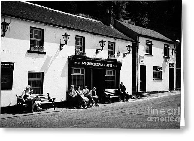 Tourists Outside Fitzgeralds Pub In The Village Of Avoca From The Tv Series Ballykissangel Greeting Card by Joe Fox