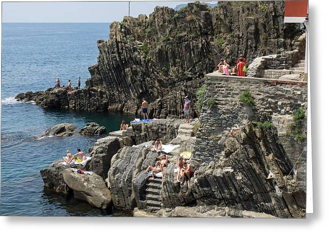 Tourists Sunbathing On The Rocks Greeting Card by Panoramic Images
