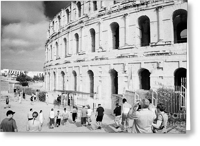 Tourists Walk Down Steps Towards  The Main Entrance Of The Old Roman Colloseum Against Blue Cloudy Sky El Jem Tunisia Greeting Card