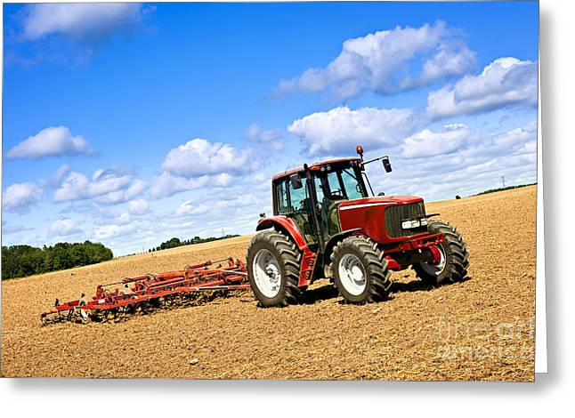 Tractor In Plowed Farm Field Greeting Card by Elena Elisseeva