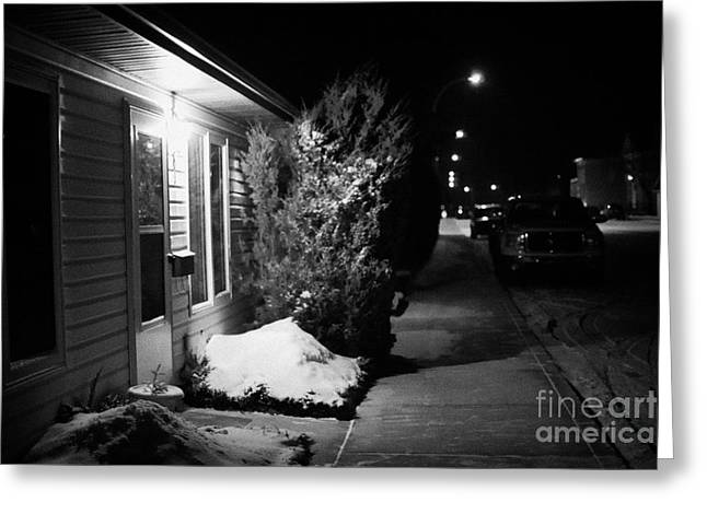 Traditional House With Porch Light Outside The Door And Snow Cleared Pavements At Night Delisle Sask Greeting Card