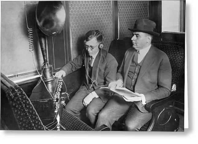 Train Passengers Enjoy Radio Greeting Card by Underwood Archives
