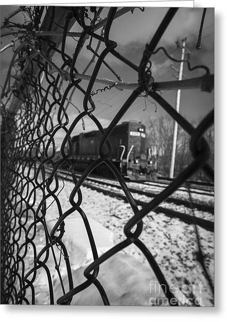 Train Through The Chain Link Fence Greeting Card by Edward Fielding