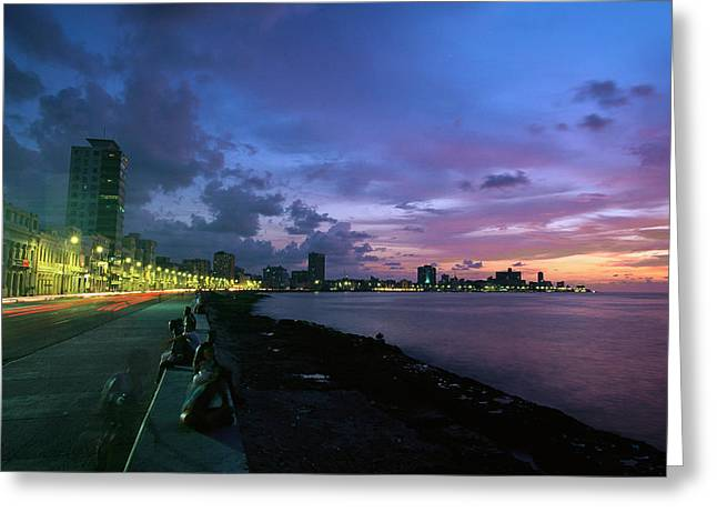 Twilight View Of Young Cubans Sitting Greeting Card by Steve Winter
