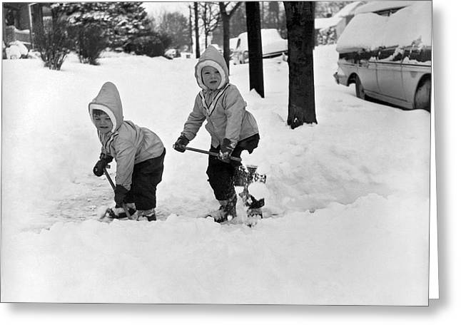 Two Children Shoveling Snow Greeting Card by Underwood Archives