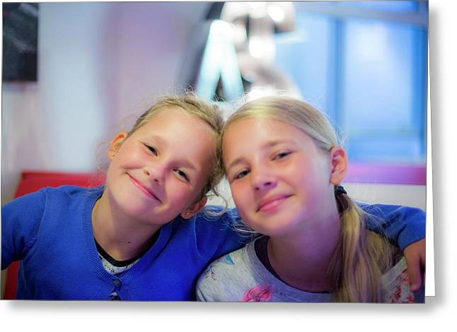 Two Girls Smiling Arms Around Each Other Greeting Card by Samuel Ashfield