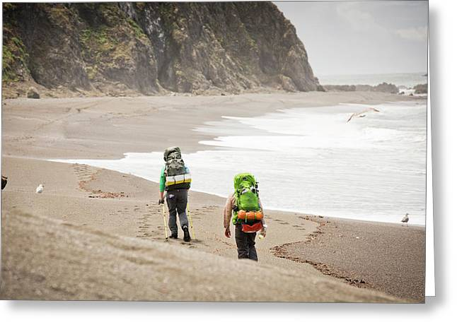 Two Hikers On A Sandy Beach Greeting Card