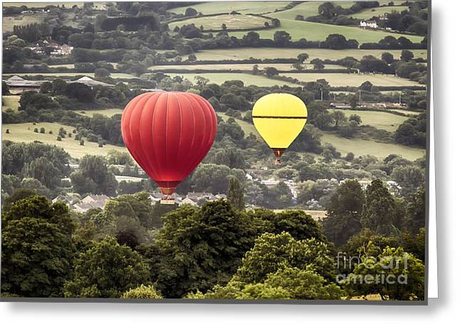 Two Hot Air Baloons Drifting Greeting Card by Simon Bratt Photography LRPS