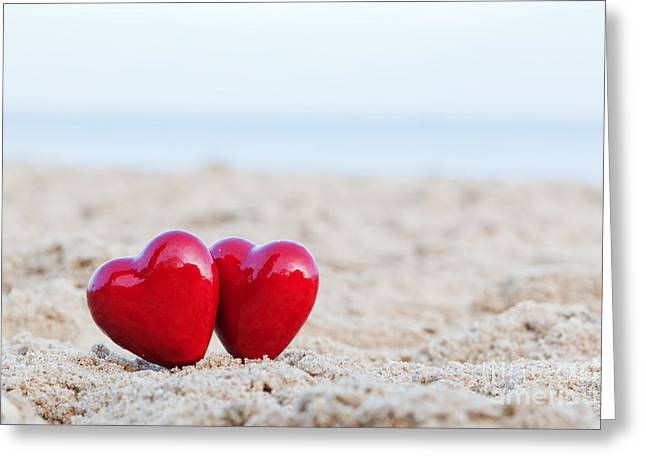 Two Red Hearts On The Beach Symbolizing Love Greeting Card