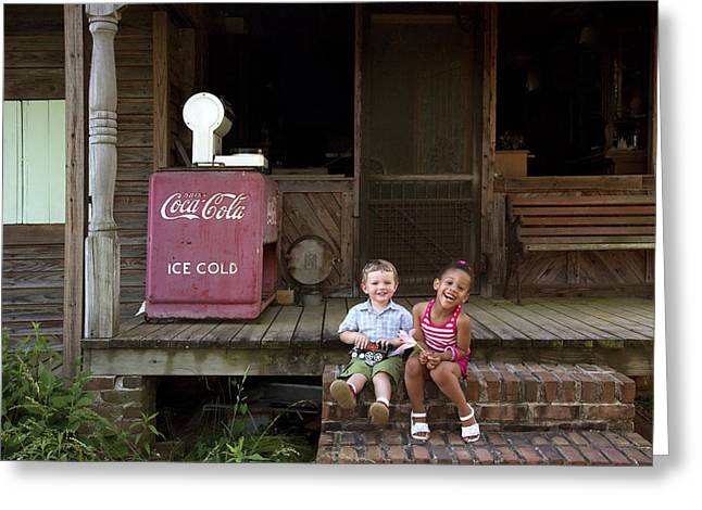 Two Young Children Pose On The Steps Of A Historic Cabin In Rural Alabama Greeting Card