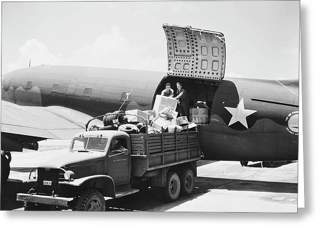 Unloading Cargo From A U.s. Army Air Greeting Card by Stocktrek Images