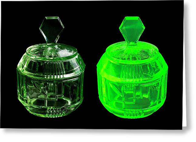 Uranium Glass Fluorescing Greeting Card by Science Photo Library