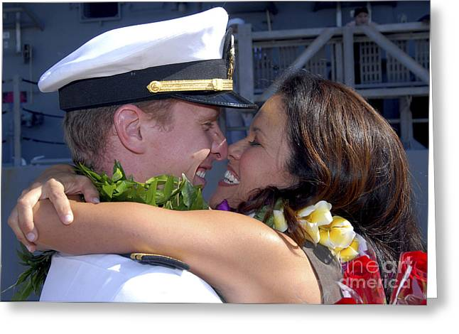 U.s. Navy Sailor Greets His Wife Greeting Card by Stocktrek Images