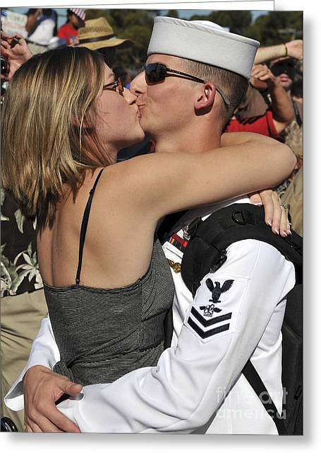 U.s. Navy Sailor Is Kissed By His Wife Greeting Card by Stocktrek Images
