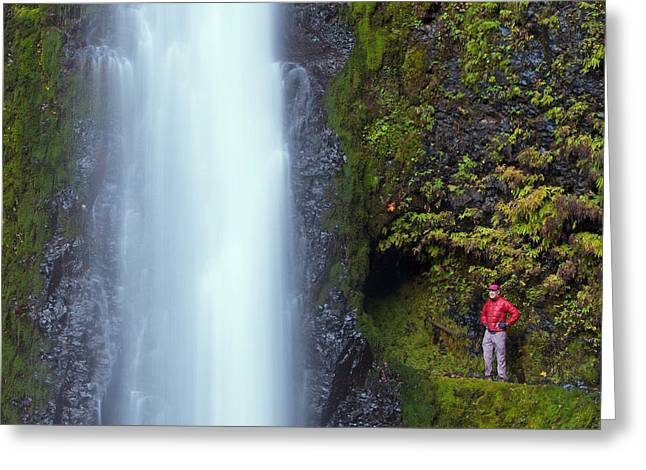 Usa, Oregon A Man In Red Stands Aside Greeting Card by Gary Luhm