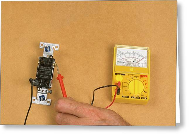 Using Electric Gauge To Test Current Greeting Card by Dorling Kindersley/uig