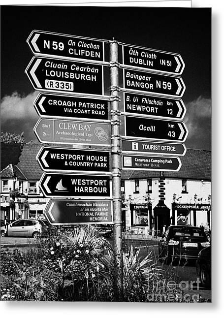 Various Road Direction Signs In Westport County Mayo Republic Of Ireland Greeting Card by Joe Fox