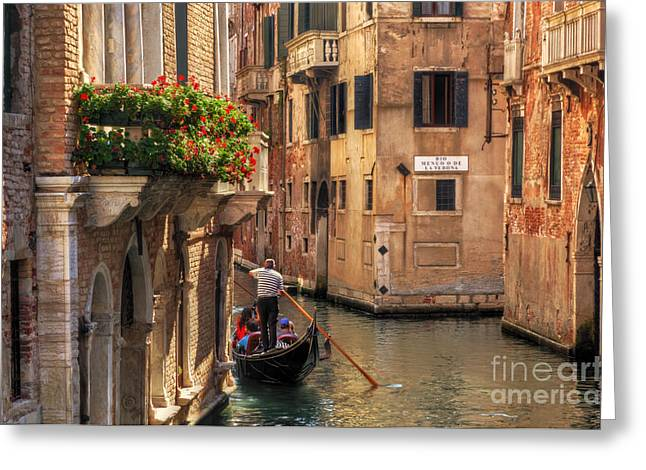 Venice Italy Gondola Floats On A Canal Among Old Venetian Architecture Greeting Card by Michal Bednarek