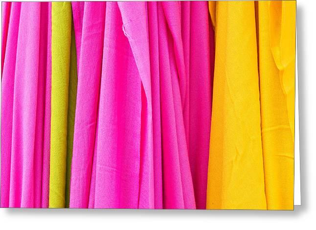 Vibrant Cloths  Greeting Card by Tom Gowanlock