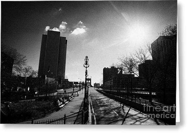view looking along the Brooklyn bridge in blue sky with winter sunshine sun new york Greeting Card