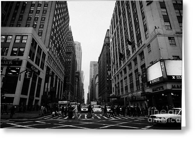 view of pedestrians crossing crosswalk on 7th Avenue and 34th Street outside macys new york city usa Greeting Card by Joe Fox