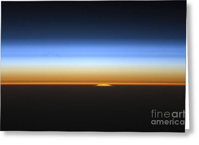 View Of The Sun Peeking Over The Limb Greeting Card by Stocktrek Images