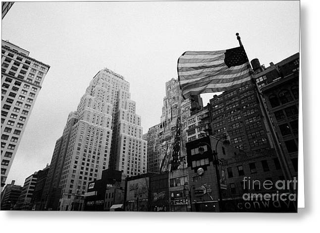 view of US flag flying on 34th street from 1 penn plaza new york city usa Greeting Card by Joe Fox