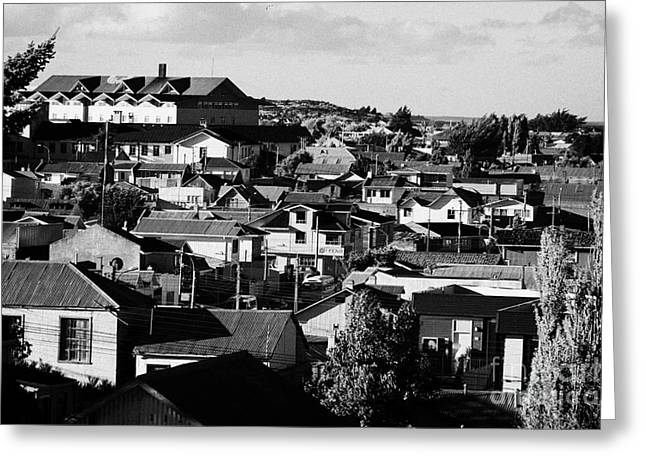 view over rooftops in local neighbourhood in Punta Arenas Chile Greeting Card by Joe Fox