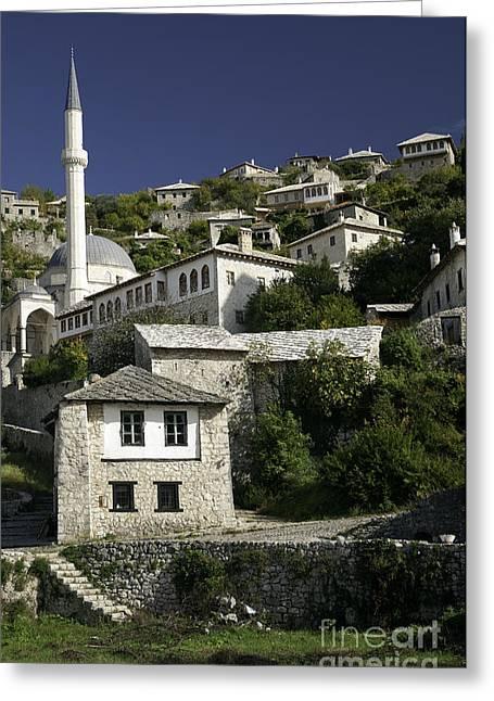 views of pocitelj in Bosnia Hercegovina with minaret bridge and river Greeting Card