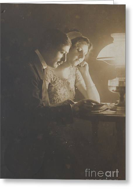 Vintage Loving Couple Reading With Oil Lamp Greeting Card
