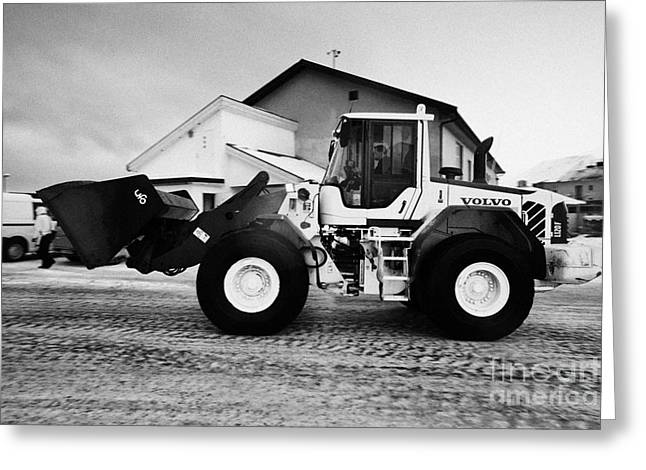 volvo wheel loader carrying grit and stones for icy road use Honningsvag finnmark norway europe  Greeting Card by Joe Fox