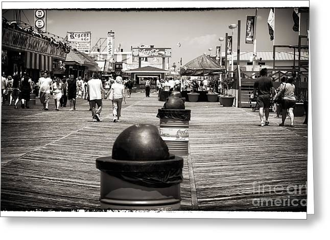 Walking The Boardwalk Greeting Card by John Rizzuto