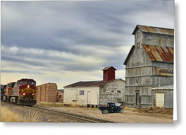 Warbonnet Passing The Grain Elevator Greeting Card by Ken Smith