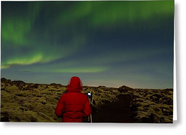 Watching The Northern Lights Greeting Card by Andres Leon