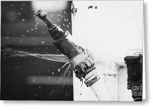 Water Escaping From A Loose Fitting Hose And Tap On Orange Post Kilkeel Harbour County Down Northern Ireland Greeting Card by Joe Fox