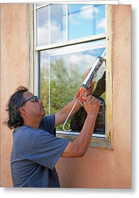 Weatherproofing Windows Greeting Card by Jim West