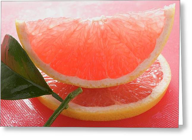 Wedge Of Pink Grapefruit On Slice Of Grapefruit With Leaf Greeting Card